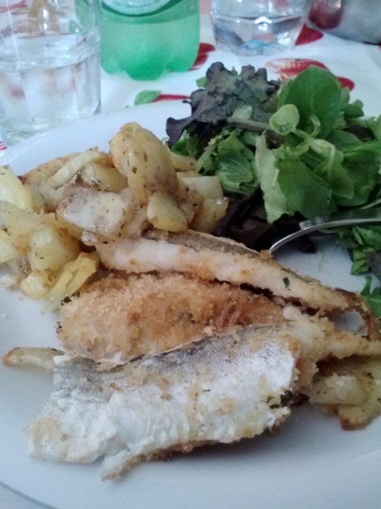 Merluzzo al forno con patate. Baked fish with potatoes.