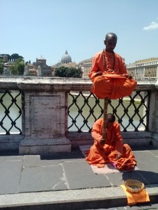Monks meditating on the Tiber River.