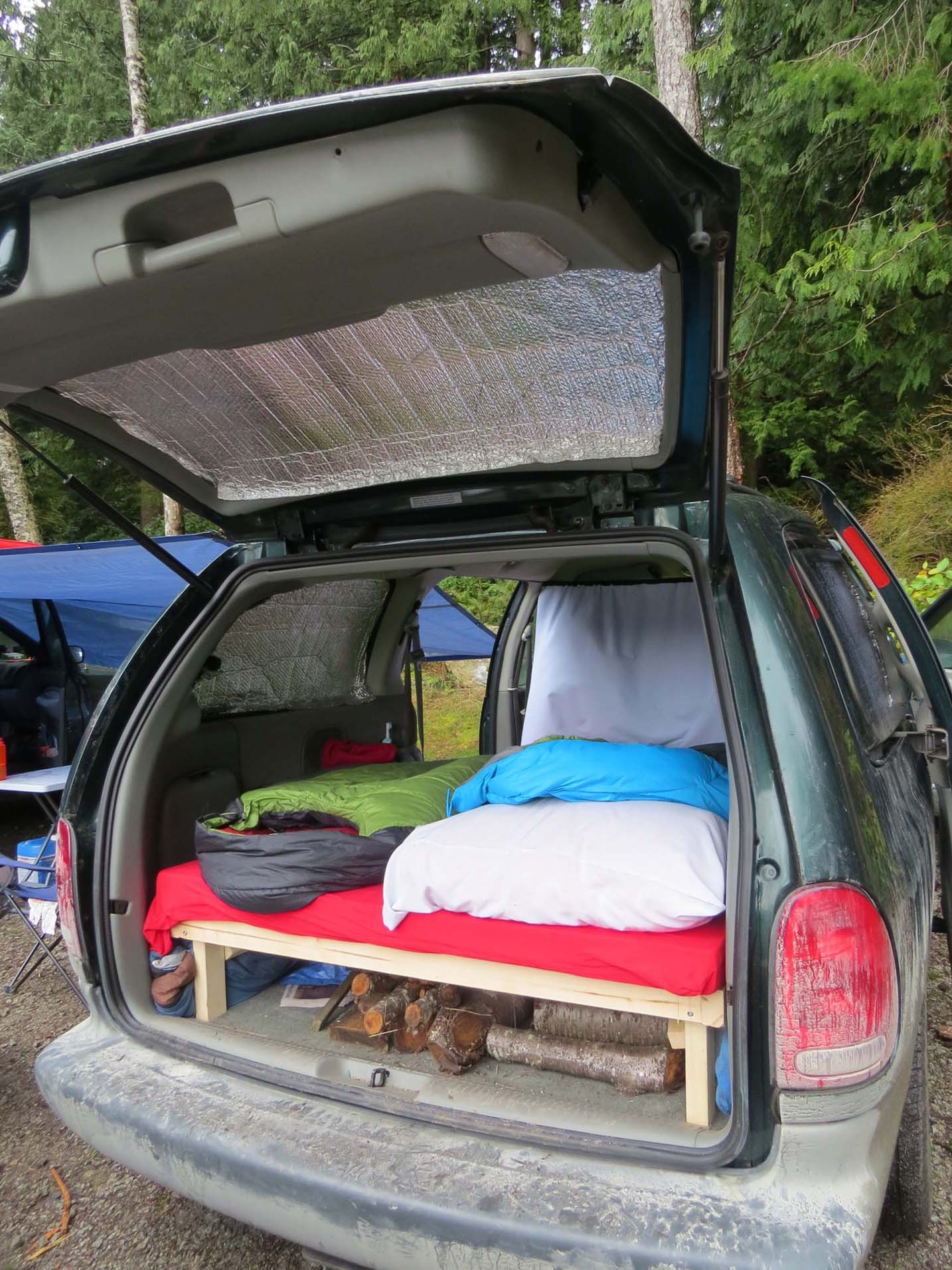 Plymouth Grand Voyager And Mazda 4x4 Van Conversions Off