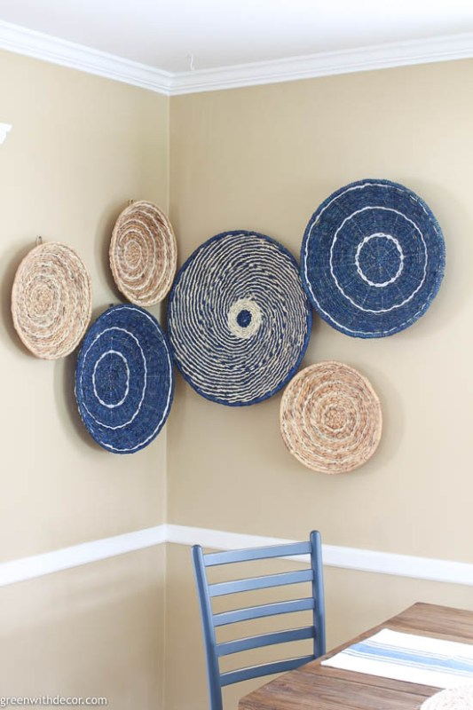 This basket wall from Green with Decor is a beautiful example of how to use woven basket wall decor in a coastal-styled home.