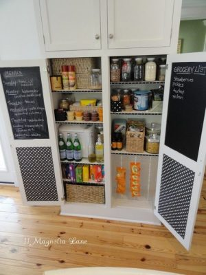 How cute is this pantry? I love the chalkboard on the doors!
