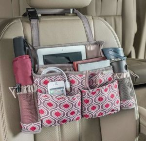 Use a swing away car seat organizer to store your car essentials.