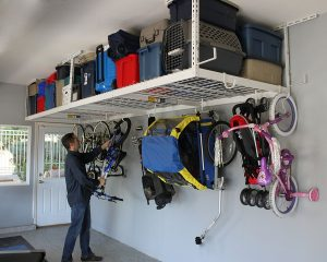 Use an overhead ceiling rack to store large items.