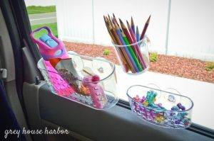 If going on a road trip, install sink caddies to store snacks and other supplies for your kids.