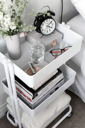 Swap out your traditional bedroom side table for a mobile rolling cart. Its way more practical.