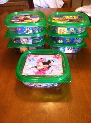 Use dollar store containers to store puzzle pieces and other small toys.