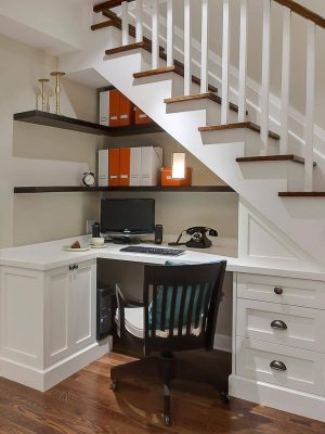 Make use of the space under you stairwell to create an office nook.