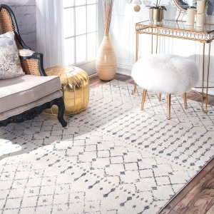 "How lovely is this distressed patterned area rug? This would pair great in a home office or ""girl cave""."