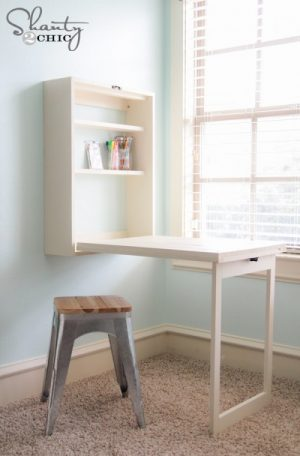 DIy Murphy Table to save space in your home office. How sweet?