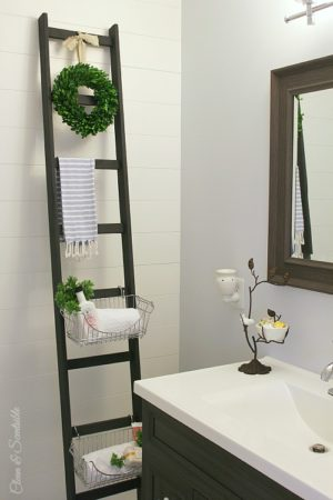 DIY storage ladder e1500427271566 - 11 Super Creative Ways to Organize Your Bathroom Using Baskets