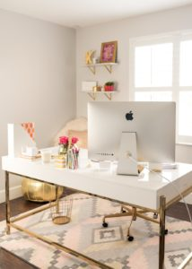 How feminine and chic is this home office? I love the gold and pink decor.