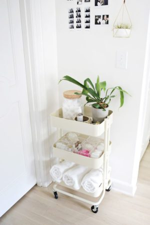 A mobile cart will be a lovely addition to a guest bedroom. You can store and organize towels and other bathroom toiletries.