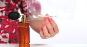 Spray q-tips with your favorite perfume and store in a ziplock bag. You can use these later during the day when you need a quick touch up.