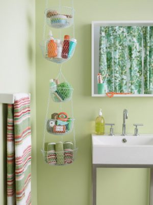 Use hanging planter baskets to store towels, shampoo, and other bathroom essentials.