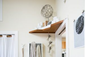 Add shelving above your doors for additional storage space.