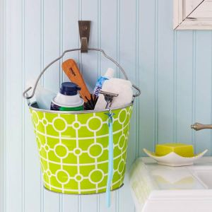 Use a bucket to store hair supplies in a small bathroom. Repin for later!