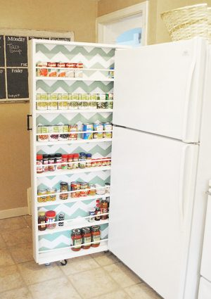 No pantry, no problem. This DIY canned food organizer saves space by neatly fitting between your refrigerator and kitchen wall .