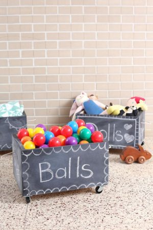 Use chalkboard spray paint to label and organize your kids' toys.