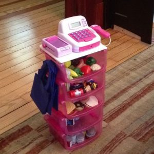 Stack dollar store bins on top of each other and add a register to make this cute little play register/toy organizer. Repin if you love this idea!
