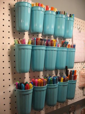 Use dollar store cups to organize your craft supplies using a simple pegboard. Repin if you think this is brilliant!