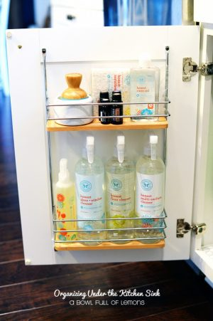 Use a hanging organizer to store items underneath your kitchen sink.