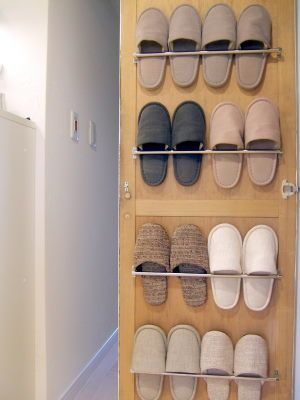 use a towel rack to store your slippers and other shoes