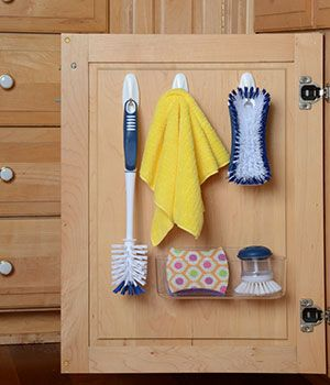 Use Command Hooks on the back of your kitchen sink cabinet's door to store your kitchen cleaning supplies.