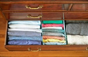 Fold your clothes vertically in your dresser to save space and prevent clutter.