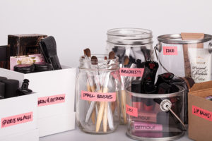 Separate your makeup into containers and label them.