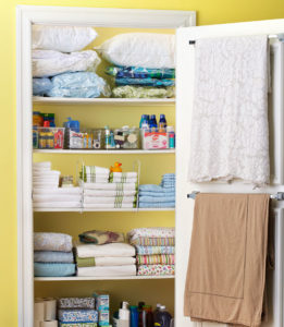 Use towel racks in your linen closet to hang blankets or other items. Repin if you like this idea!