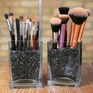 Use clear containers and decorative sand to store your makeup brushes. Repin if you think this is a cool idea!