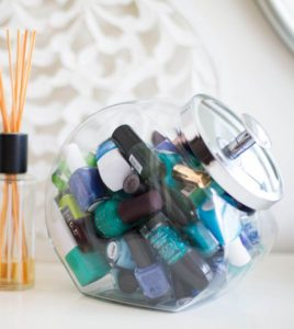 Store your lipstick, nail polish and other beauty supplies in a candy jar. Repin if you think this is a cool idea!