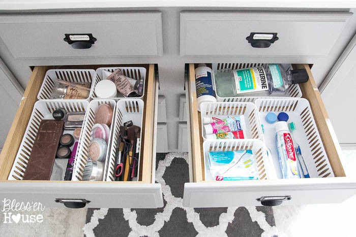 Organize bathroom drawers using cheap plastic bins from the dollar store.