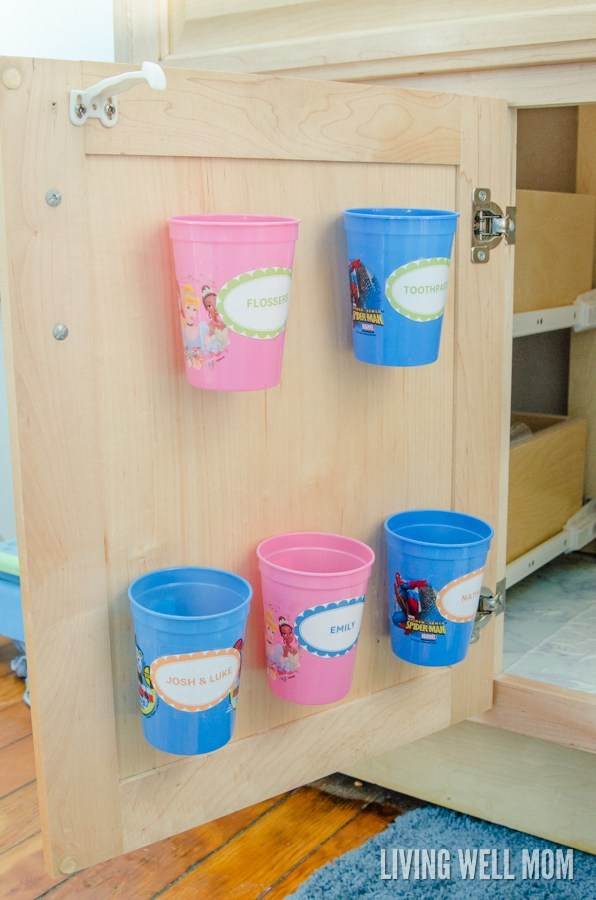 Organize kids toothbrushes using dollar store cups.