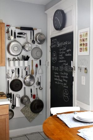Install a pegboard in your tiny kitchen to hang pots and pans. This will save so much space.