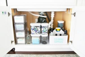 Use plastic containers to organize underneath your kitchen sink.