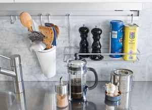 Use a pot rail in your small kitchen to add storage space.