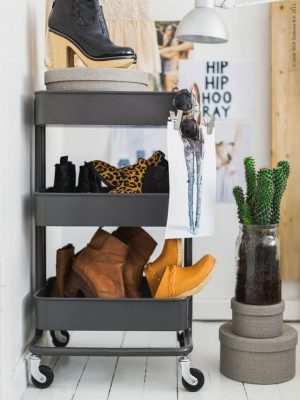 Use a mobile cart to store shoes in a small apartment.