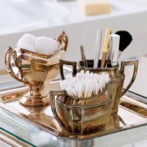 Repurpose an old tea set to organize your makeup and other beauty supplies.