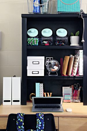 Place a shelf on top pf your computer desk to add more storage space in a small room.