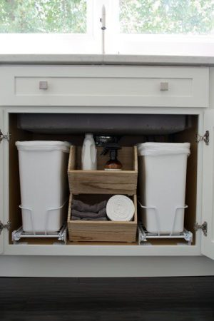 Install pull out drawers to keep trash bins underneath your kitchen sink.