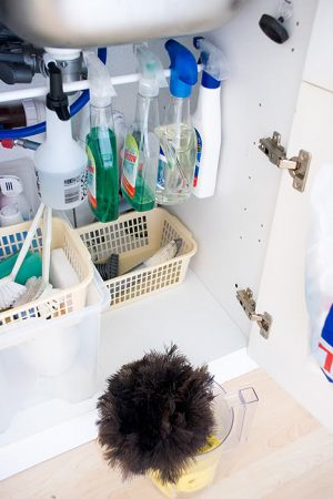 Use tension rods under the sink to hang cleaning products and other items.