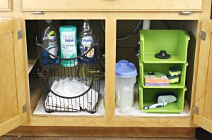 Use stackable bins to organize under your kitchen sink.