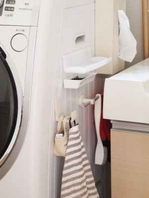 Japanese laundry room hack. Use the small space next to your washer to hang essentials.