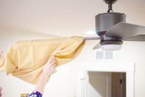 Use an old pillowcase to dust your ceiling fan blades. You will never have to worry about getting dust everywhere when you clean.