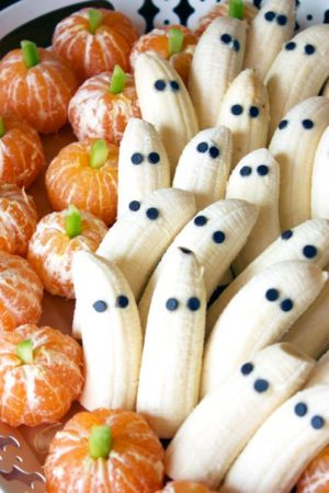 Halloween food idea- Banana ghosts and tangerine pumpkins.