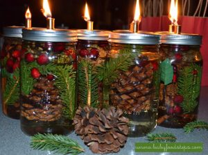 Make your own mason jar candles to make your home smell like christmas!