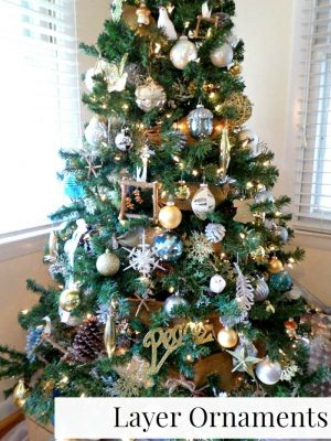 Make your christmas tree appear fuller by layering ornaments.