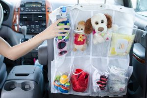 Use a shoe organizer in your car to your kid's things.