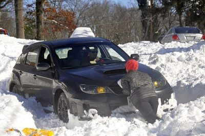 Get you car unstuck from the snow by using rubber mats or kitty litter.
